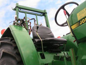 Low angle of the cab of a John Deere tractor.